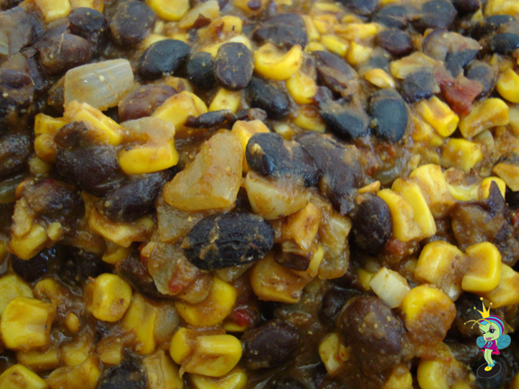 1st I make the filling with black beans, chipotle, corn & onion