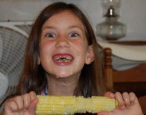 Girl eating corn on the cob