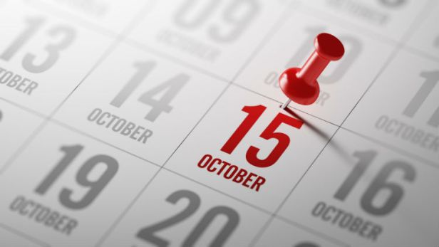 October 15 marked on calendar with a red thumbtack