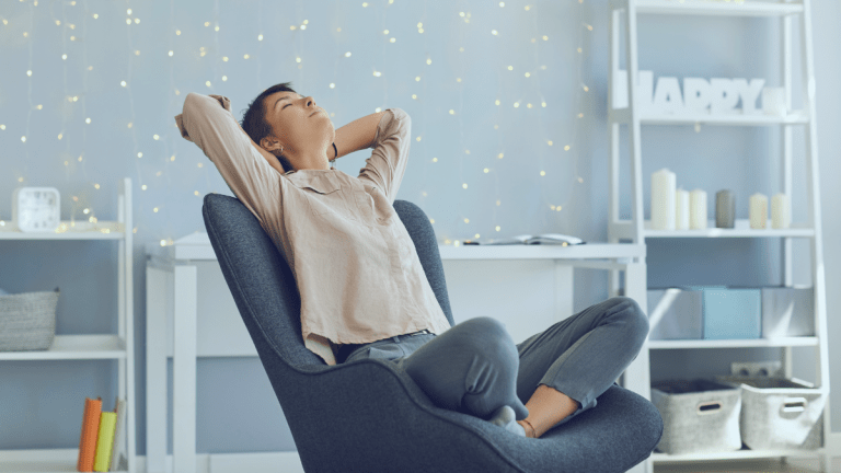 woman sitting on chair with eyes closed