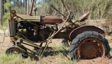 photo of broken tractor in field