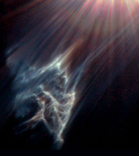 This image shows a dark interstellar cloud ravaged by the passage of Merope, one of the brightest stars in the Pleiades star cluster. Just as a torch beam bounces off the wall of a cave, the star is reflecting light from the surface of pitch-black clouds o