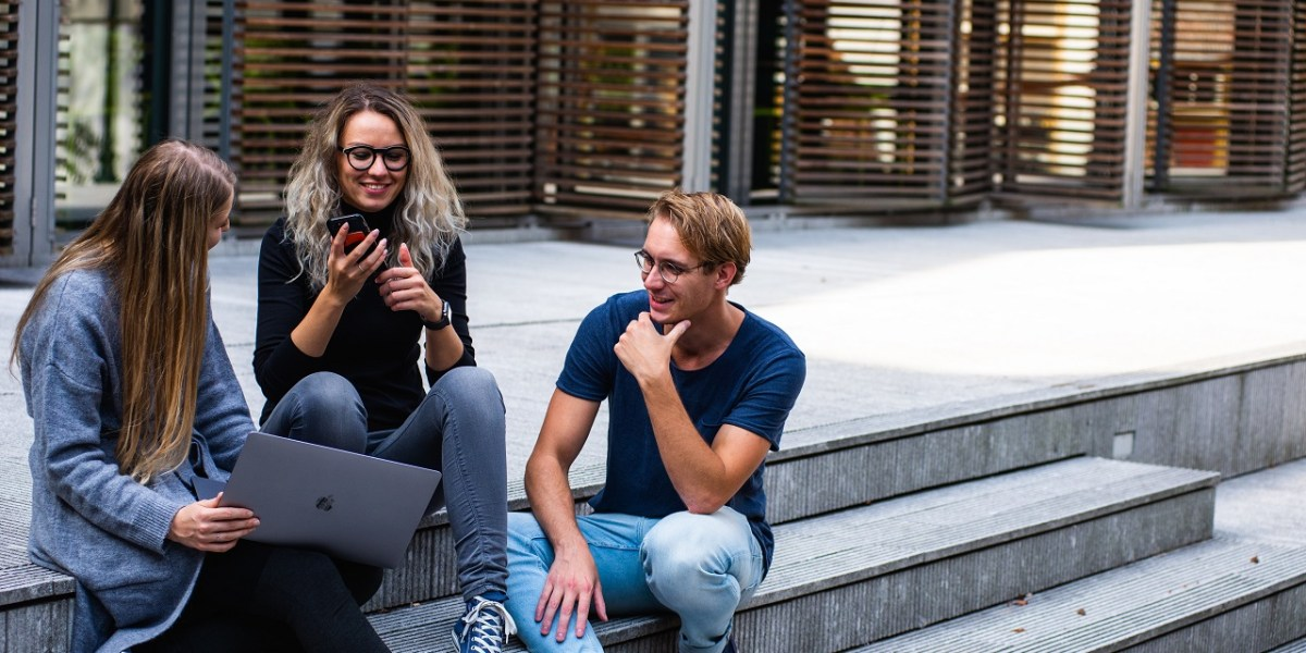 three students discussing