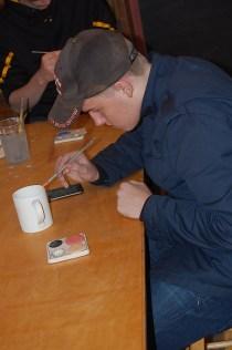 Henry Sharpe works on a ceramic piece.