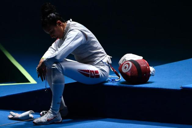 TOPSHOT - Tunisia's Ines Boubakri reacts after losing Italy's Elisa di Francisca in their women's individual foil semi-final bout as part of the fencing event of the Rio 2016 Olympic Games at the Carioca Arena 3 in Rio de Janeiro on August 10, 2016. / AFP PHOTO / Fabrice COFFRINIFABRICE COFFRINI/AFP/Getty Images