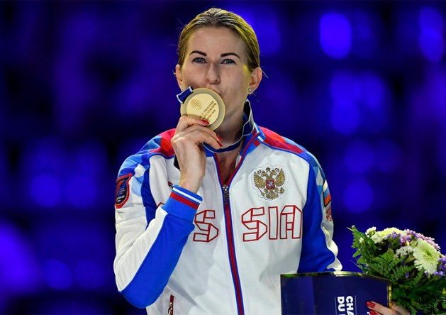 Gold medalist Inna Deriglazova of Russia celebrates on the podium after defeating Pauline Ranvier of France in the women's individual foil final of the FIE World Fencing Championships in Budapest, Hungary, 19 July 2019.  EPA-EFE/Tibor Illyes HUNGARY