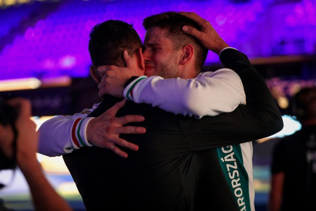 Gergely Siklosi with his mentor Gábor Boczkó, crying of the winning joy