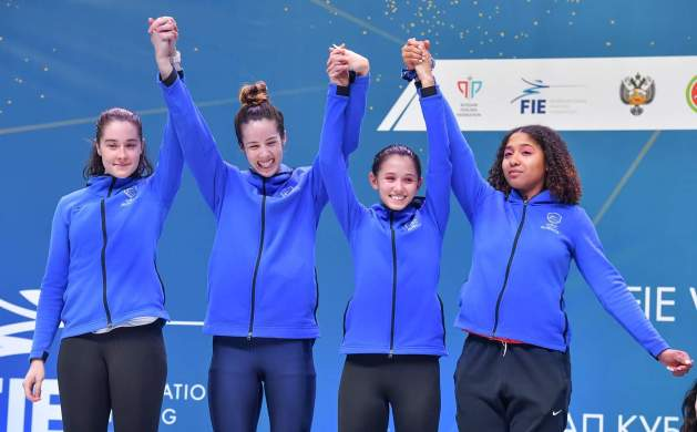 2019 World Cup in Kazan, Russia. USA Women's Foil Team Gets a Silver Medal. From left to right: Jackie Dubrovich, Sabrina Massialas, Lee Keifer, Iman Blow