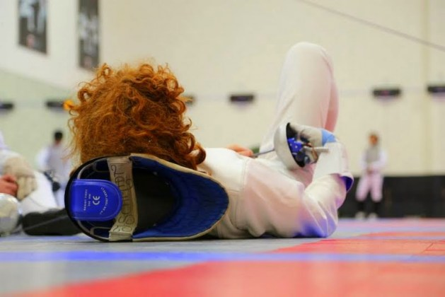 A fencer takes a rest between the bouts to fight fencing fatigue