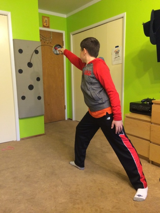 Bartosz Kuligowski (Y10 epee) complements his fencing training in the club with fencing target training at home