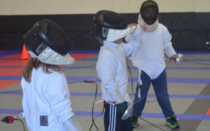Beginner fencers learn to deal with looses during their fencing training practice