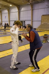 Coach provides his fencer an advice during a break in a bout