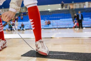 Sabre fencer straightens his weapon during a fencing bout at Pan-American Championship 2015