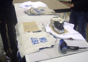 Fencing uniform stenciling at NAC by fencing equipment vendor