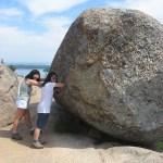 Trying to push Bubble Rock in Acadia National Park a popular activity