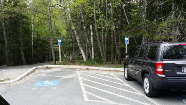 Accessible parking for a van is located next to the accessible Jordan Pond nature trail at Acadia National Park