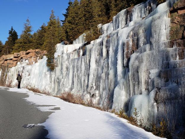 Ice covers the granite cliffs on Cadillac. summit road.
