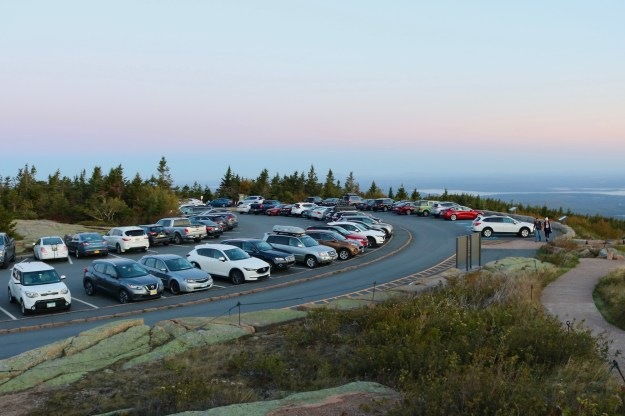 Sun rising over the parking lot at Cadillac summit in Acadia National Park
