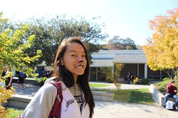 Sophomore Sabrina Lin is all smiles with her nose and whiskers. Let's hope you don't cross her path this Halloween—it's bad luck. Avoid ladders while you're at it.