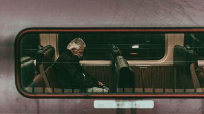 man sleeping on train