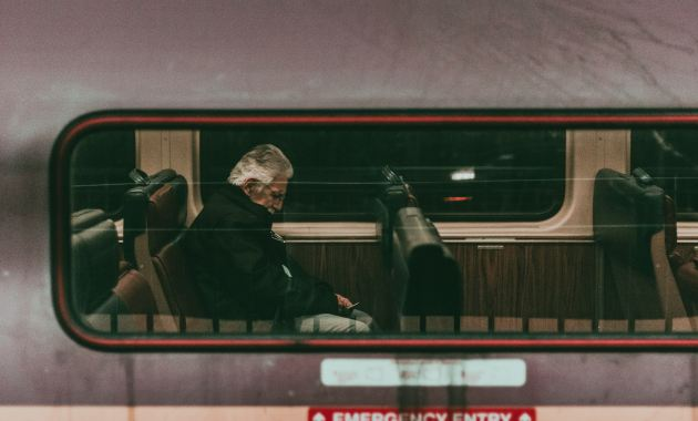 man sleeping on train
