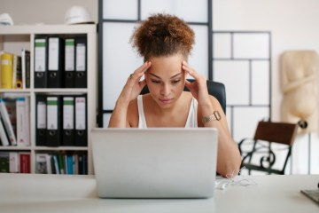 stressed woman mistakes work