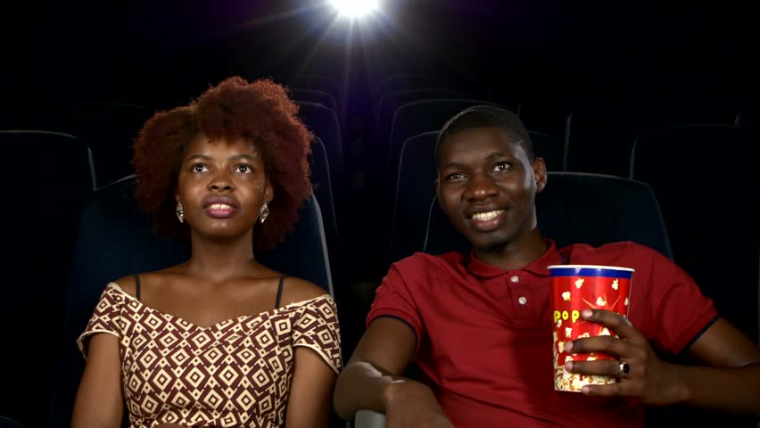 couple at the cinema watching movie