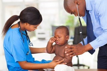 sick baby with doctor