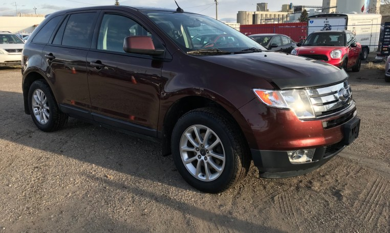Passenger view of maroon ford edge