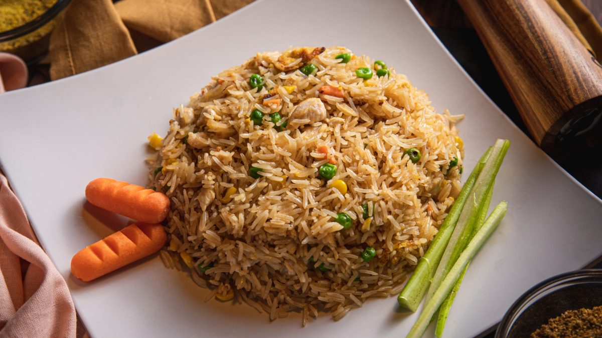 plate with fried rice and garnishes