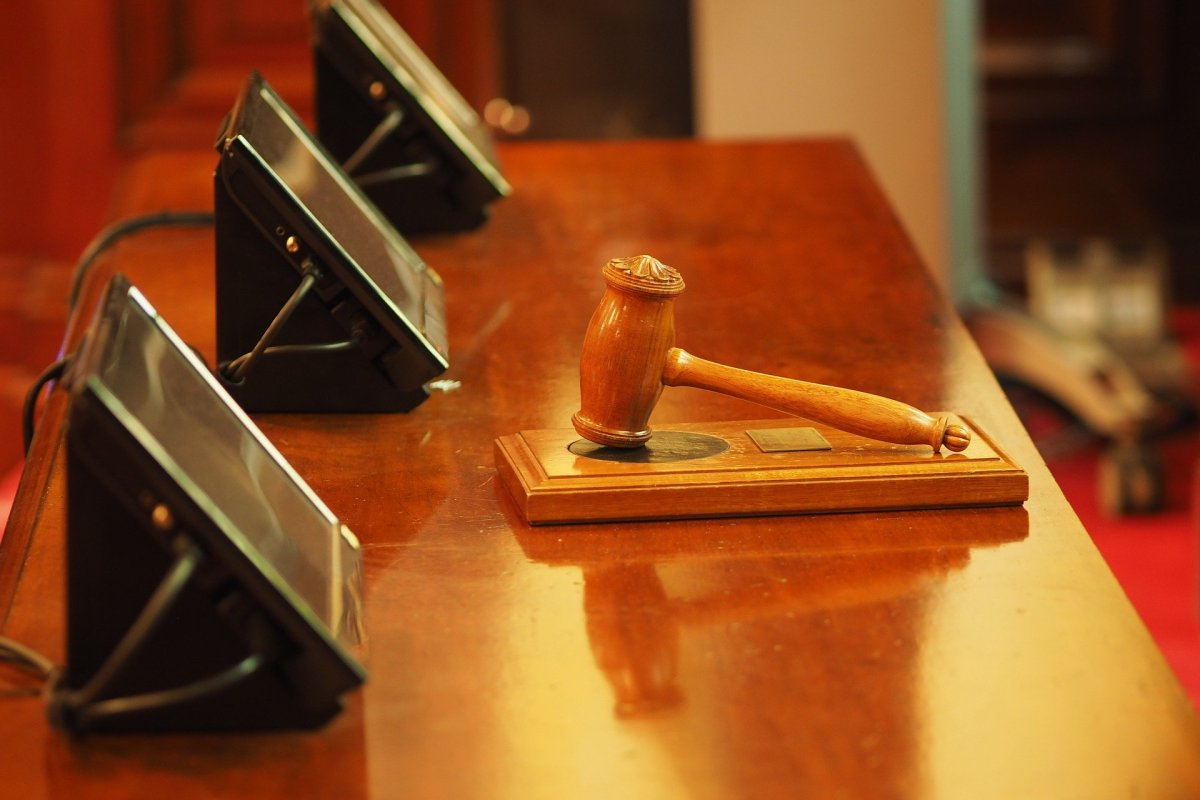 Picture of a gavel of three screens