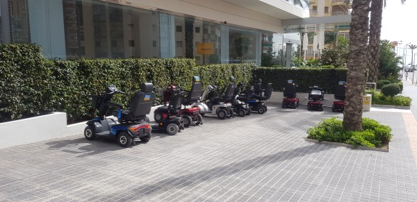 mobility scooters parking outside hotel in Spain