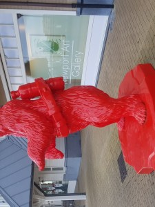 giant red polar bear wearing an oxygen set on this back. Statue photographed in the beach town of Nieuwpoort.