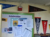 Another wall in the career center with various scholarships and more college flags