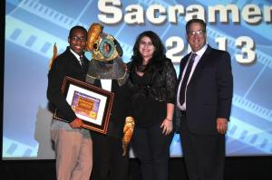 "Film ""Tailypo"" writer Dwight Taylor, his director, and Access Sacramento Executive Director on stage at A Place Called Sacramento after ""Tailypo"" wins honors as the Producer's Favorite."