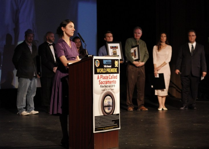"""Writer Katherine DaSailva of """"Focused"""" thanks her volunteer cast and crew from the stage of the Crest. Writer Donna Preston of """"Win, Lose or Draw"""" as the Audience Favorite Winner [Phil Kampel Photography]"""
