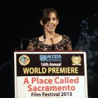 Access Sacramento Board of Directors' Chair Jo Anna Davis with greetings to the audience at the Crest Theatre for the 16th A Place Called Sacramento Film Festival. [Phil Kampel Photography]