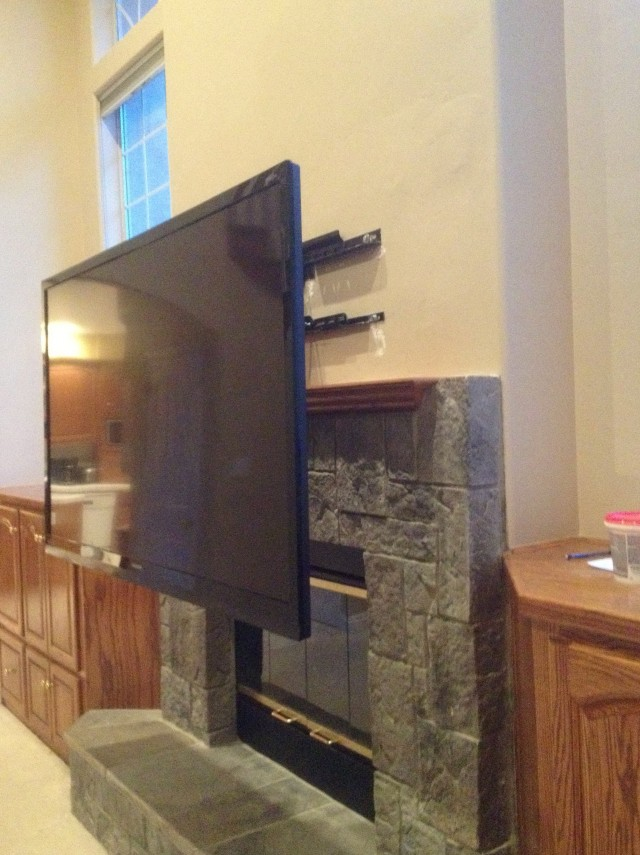 Tv Mount Pull Down Over Fireplace