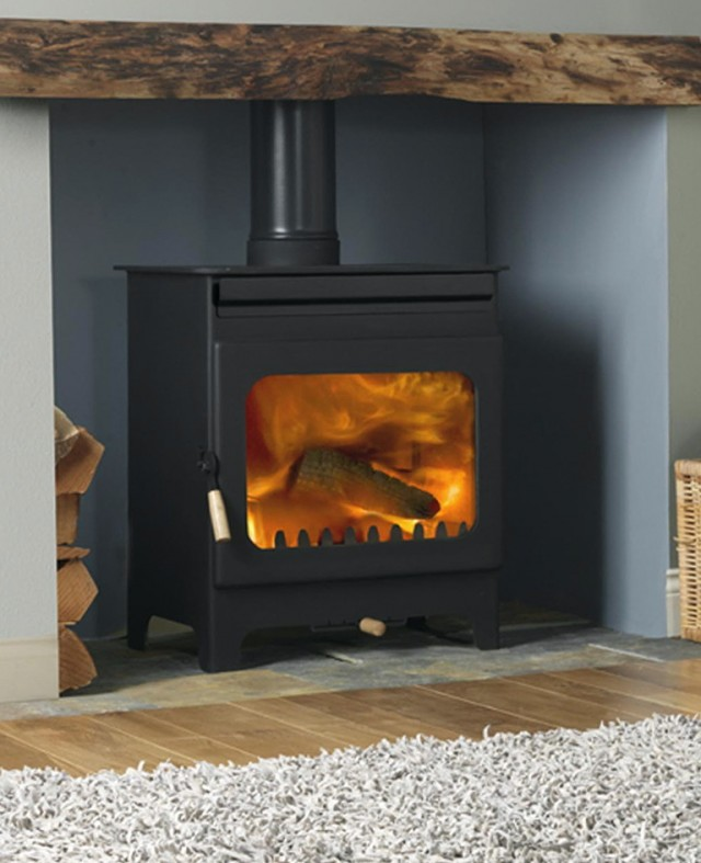 Wood Burning Stove In Old Fireplace