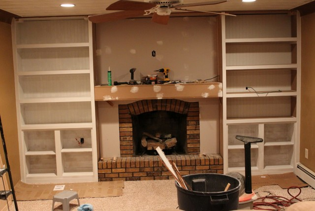 Built In Wall Shelves Around Fireplace