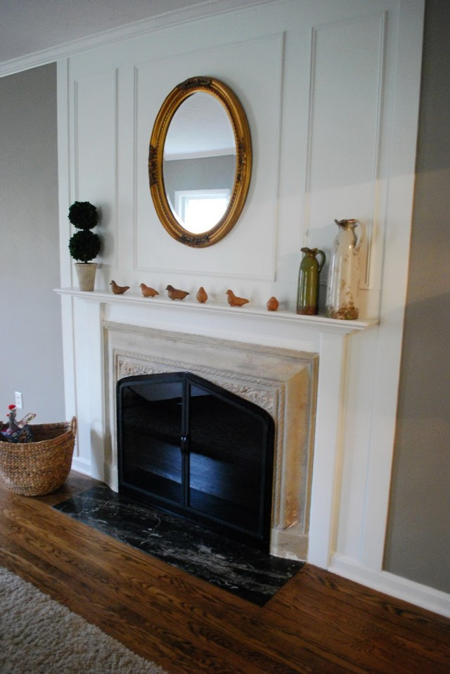 Oval Mirror Above Fireplace
