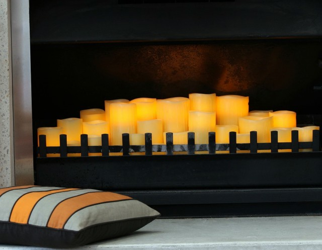 Pillar Candles In Fireplace