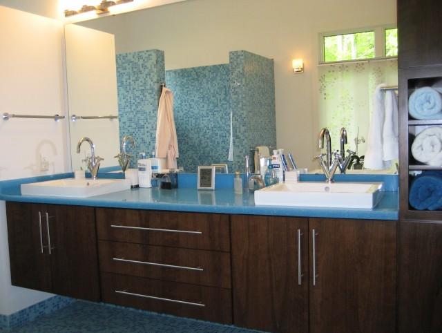 Blue Bathroom With Brown Vanity