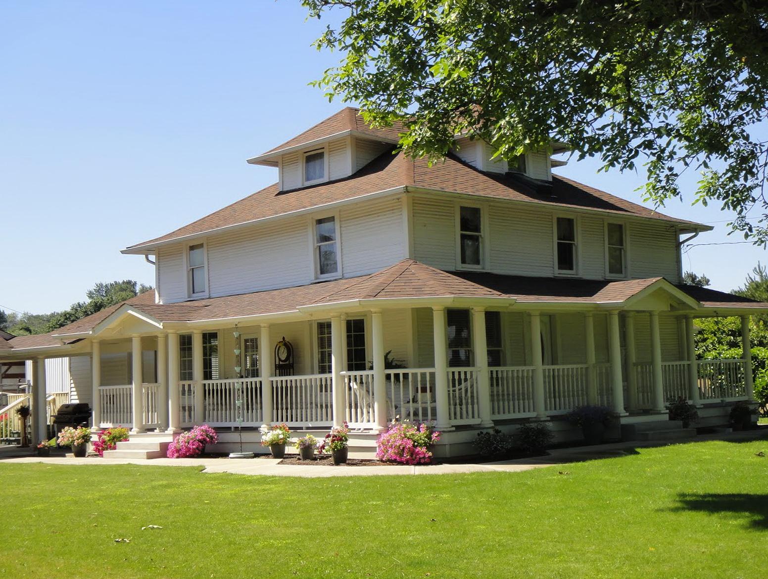 White Farmhouse Wrap Around Porch