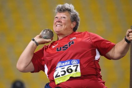 Angela Madsen is pictured wearing her red USA jersey at the Paralympics as she competes in the shot put event.