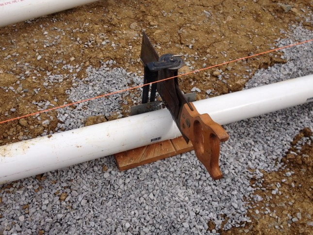 Accidental Hippies Off Grid Cordwood Home: cutting drain pipes for rough in plumbing