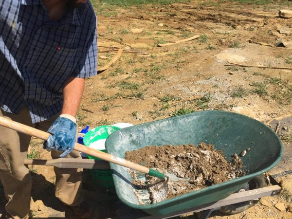 Mixing lime putty mortar for cordwood masonry - 2.5 parts sand to 1 part hydrated masonry lime