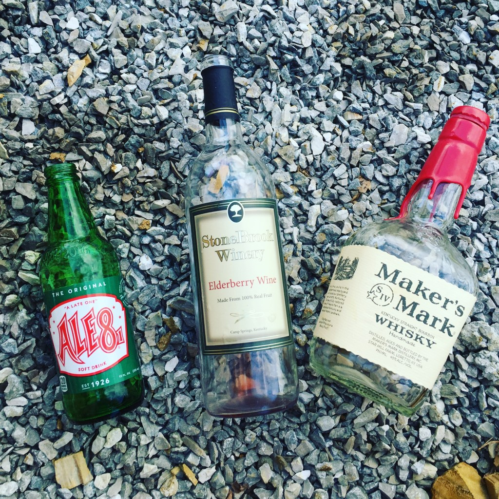 These bottles are set to be washed and used in bottle bricks on a cordwood wall - at accidentalhippies.com