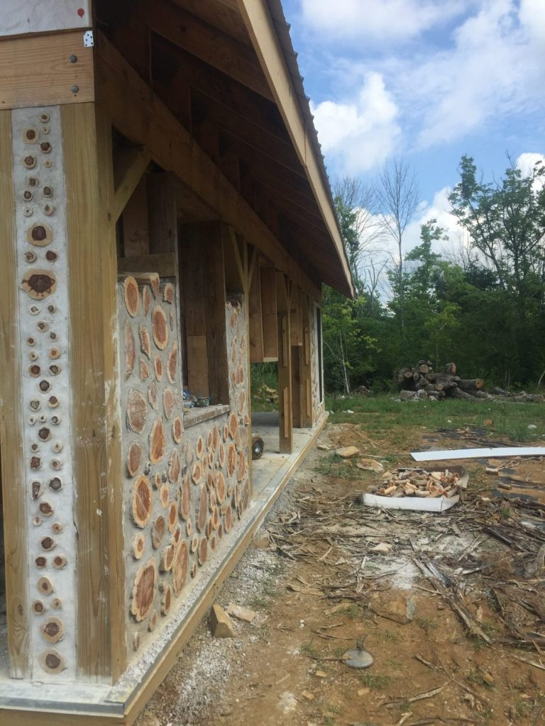 "Looking down a cordwood wall in progress -- it gives you some sense of how the ""fake"" column will look with the walls."