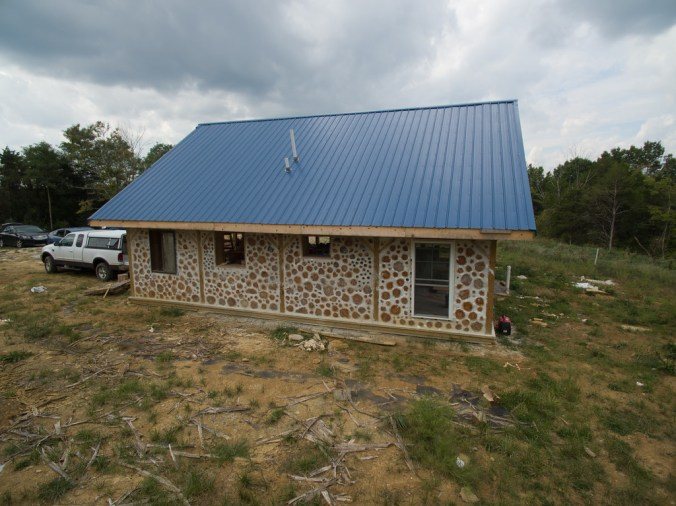East wall of a cordwood house - accidentalhippies.com
